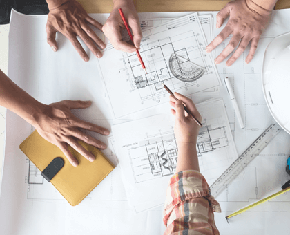 Group of people working on blueprints
